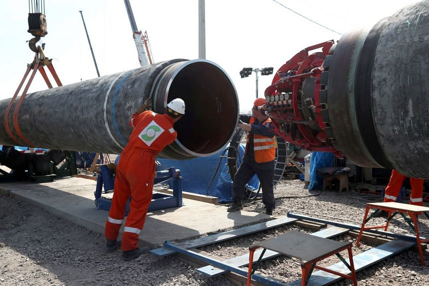 A 2019 photo shows workers at the construction site of the Nord Stream 2 gas pipeline in Russia.