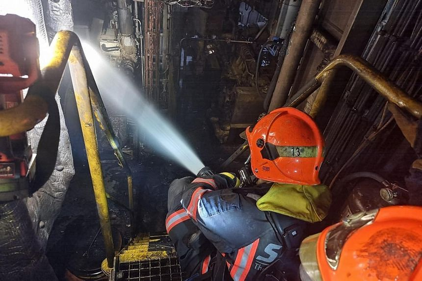Firefighters from the Singapore Civil Defence Force putting out a blaze that broke out on a tugboat berthed in West Coast on Tuesday afternoon. PHOTO: SINGAPORE CIVIL DEFENCE FORCE/FACEBOOK