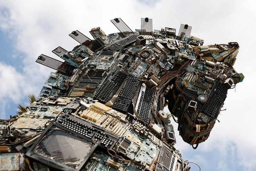 The head of a Cyber Horse exhibit, constructed with used computer and mobile phone parts infected by viruses and malware, is displayed near the entrance to the Cyber Week conference at Tel Aviv University in Israel yesterday. Israel-based creative gr