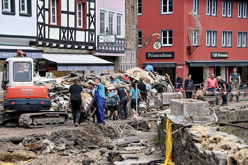 Debris being cleared on Tuesday after heavy flooding of the river Erft last week caused severe destruction in the village of Bad Muenstereifel, Germany.