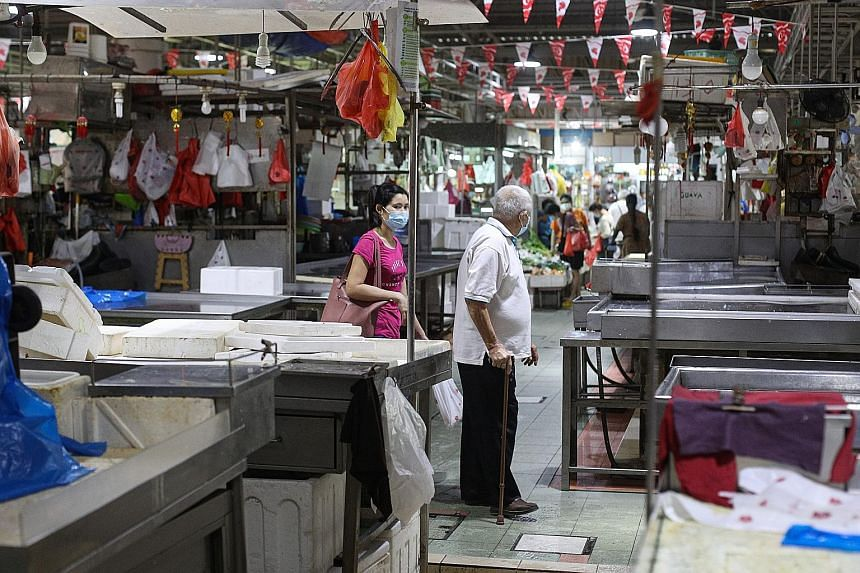 Closed seafood stalls on Sunday at Jurong West 505 Market, one of the markets linked to the Jurong Fishery Port cluster. The fishery port cluster had 130 new Covid-19 cases linked to it yesterday, bringing its total number of cases to 454.