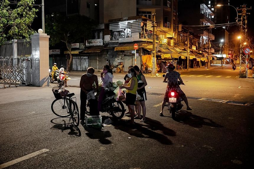 Vegetable sellers in Ho Chi Minh City venture out stealthily to ply their trade despite Directive 16 that forbids public gatherings, as well as economic activities. PHOTO: JOANIK BELLALOU