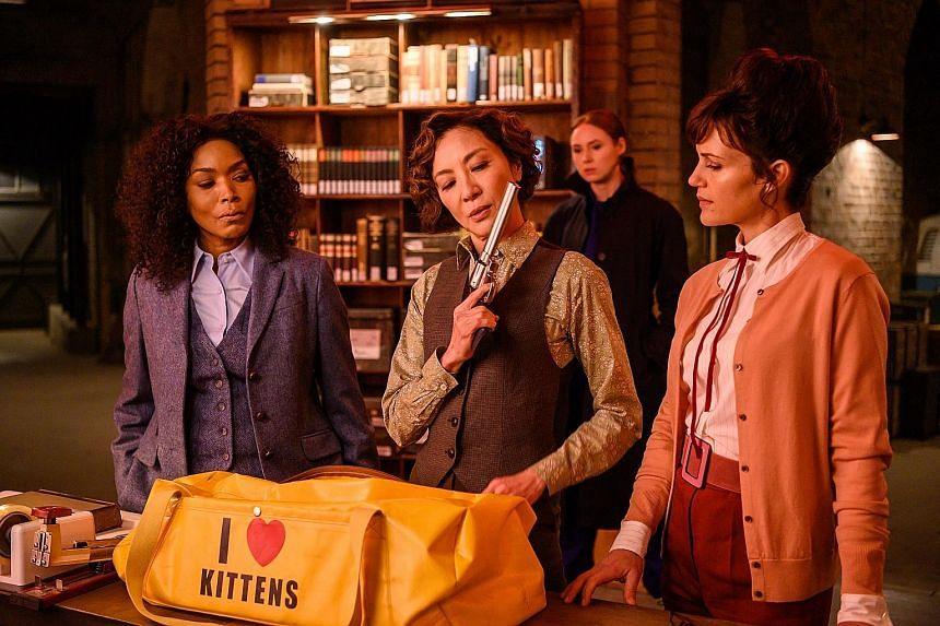 (From far left) Angela Bassett, Michelle Yeoh and Carla Gugino are custodians of a private arsenal in Gunpowder Milkshake. (Left) Henry Golding in Snake Eyes: G.I. Joe Origins.