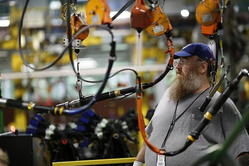 An employee working to manufacture diesel truck engines at a plant in Columbus, Indiana, in the United States. For the world economy, and for Singapore, in the age of silicon and software no less than in the age of rubber and tin, decoupling from the