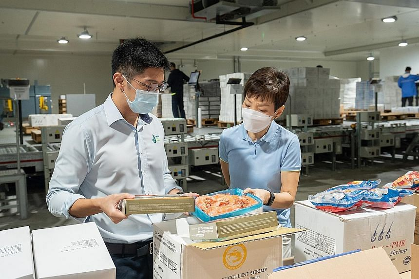 Minister for Sustainability and the Environment Grace Fu visited the Jurong Cold Store yesterday, where she observed storage facilities and stocks of frozen seafood.