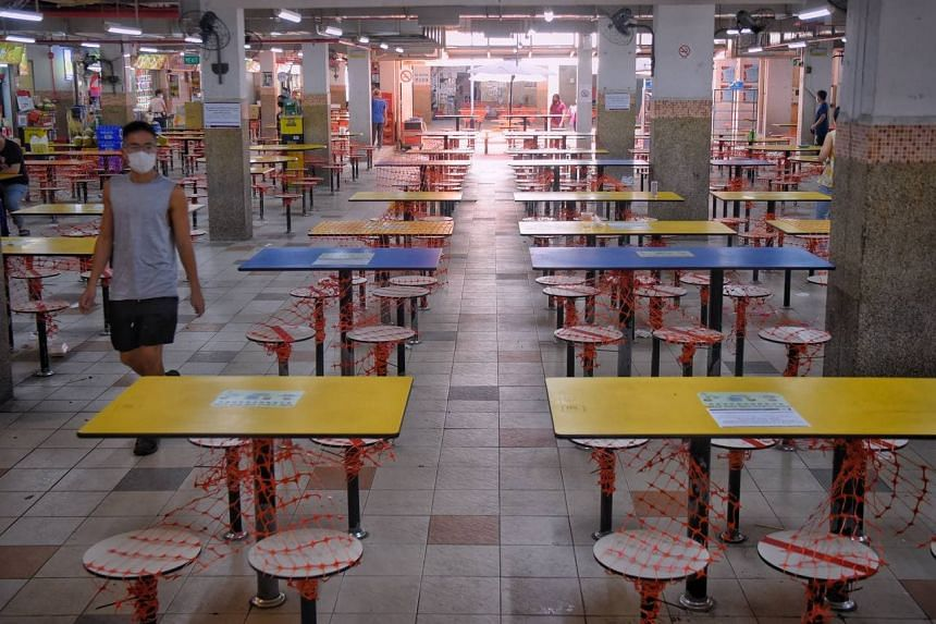 Hawker centres and coffee shops were quieter on July 22, the first day the no dine-in restriction kicks in.