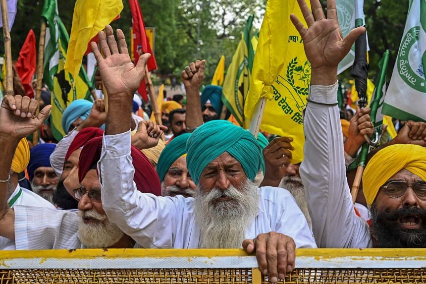 Farmers protesting against the central government's recent agricultural reforms in New Delhi on July 22, 2021.