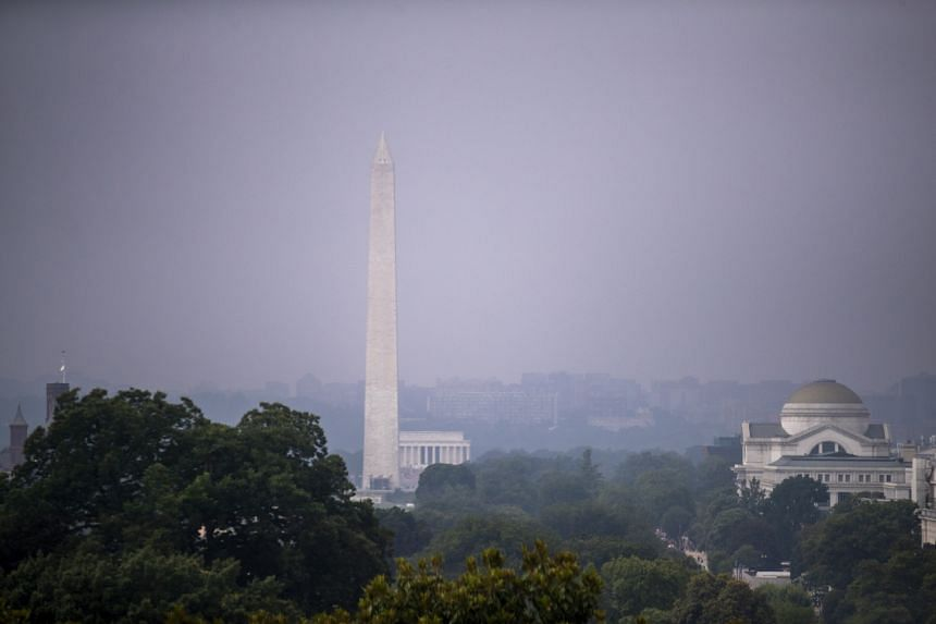 Smoke from western wildfires thickens the air in Washington on July 21, 2021.