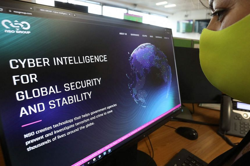 A woman checks the website of Israel-made Pegasus spyware at an office in the Cypriot capital Nicosia on July 21, 2021.