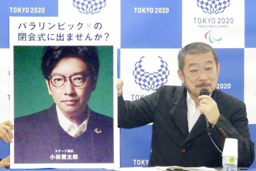 In this photo taken on December 2019, a portrait of Olympics opening ceremony show director Kentaro Kobayashi (left) is shown at a news conference in Tokyo.