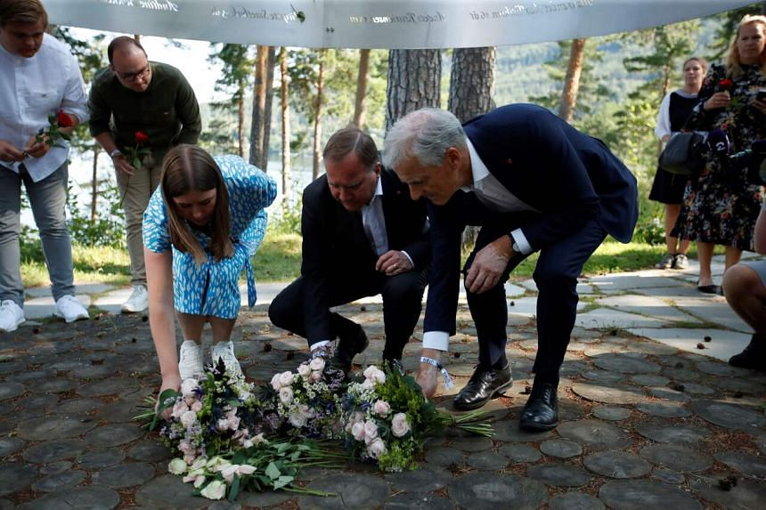 A ceremony takes place in Oslo on July 22, 2021 outside what was once the Prime Minister's Office.