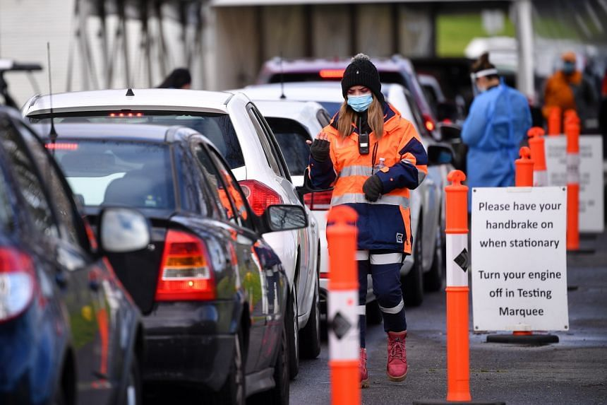 A traffic controller at a drive-through Covid-19 testing facility in Melbourne, Victoria, on July 21, 2021.