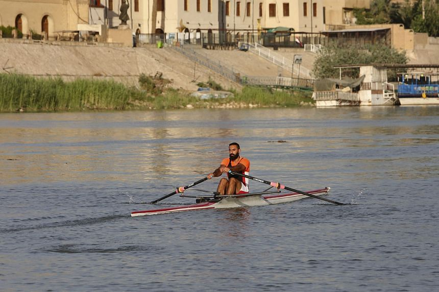 Iraqi rower Mohammed Riyadh Jasim training for the Olympics on the Tigris River. His French coach was unable to fly into Baghdad.