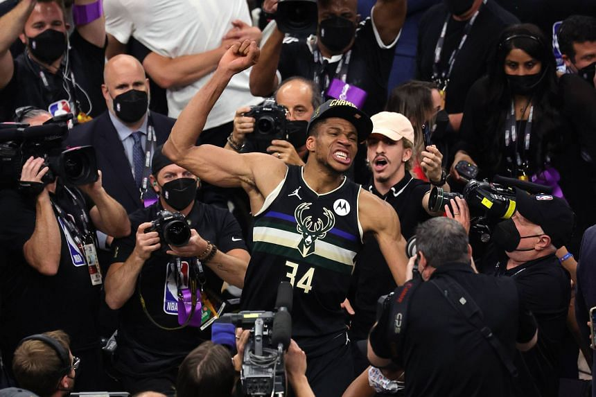 Milwaukee Bucks star Giannis Antetokounmpo celebrating after defeating the Phoenix Suns in Game 6 of the NBA Finals on Tuesday to clinch the championship. The forward averaged 35.2 points, 13.2 rebounds and five assists in six games as the Bucks won