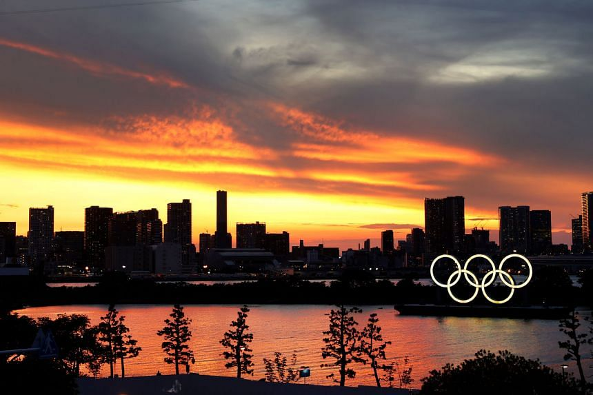 The Olympic rings are seen in front of the Tokyo skyline during sunset on Tuesday, three days ahead of the official opening of the 2020 Summer Games.