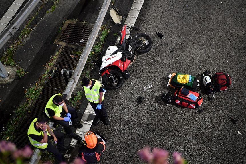 A motorcycle is seen lying on its side with debris strewn around after an accident on CTE, on July 23, 2021.