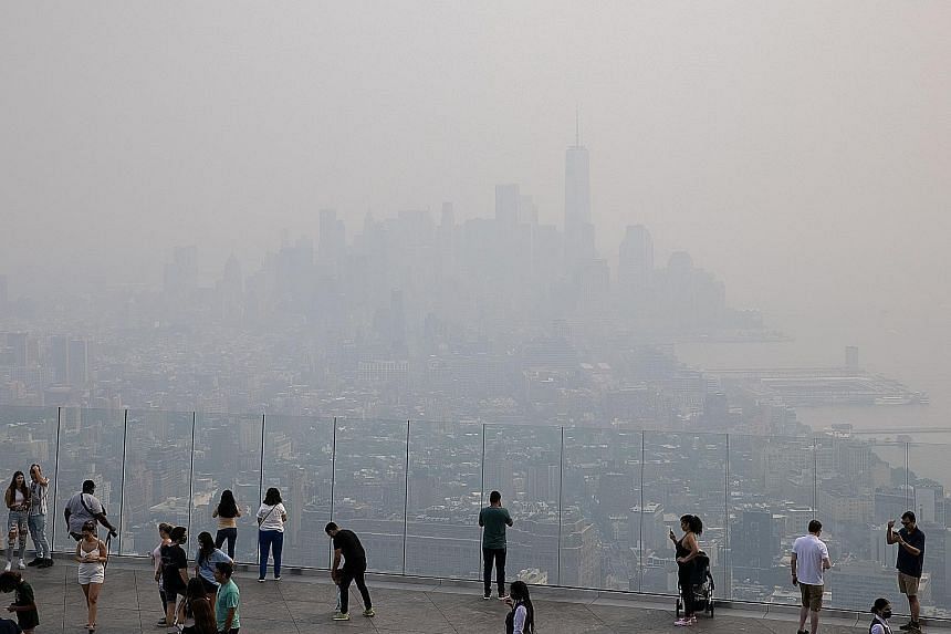 Smoke pollution from wildfires in the western United States clouding the New York City skyline on Tuesday. The city's air quality was firmly in the unhealthy range that day. PHOTO: REUTERS