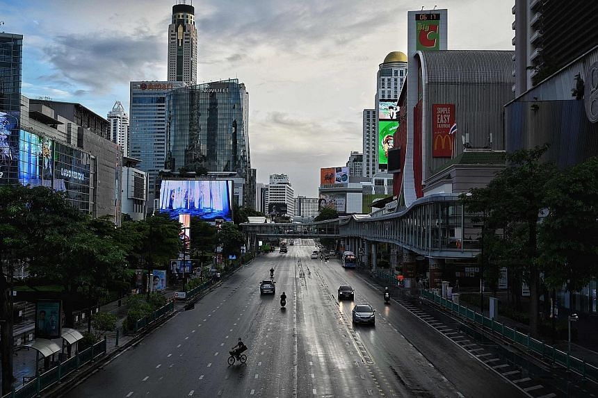 Commuters at Ratchaprasong intersection in Bangkok on July 12, the first day of stricter lockdown curbs to contain the spread of the coronavirus. The tougher measures have caused economic activity in Thailand to plummet to levels close to those reach