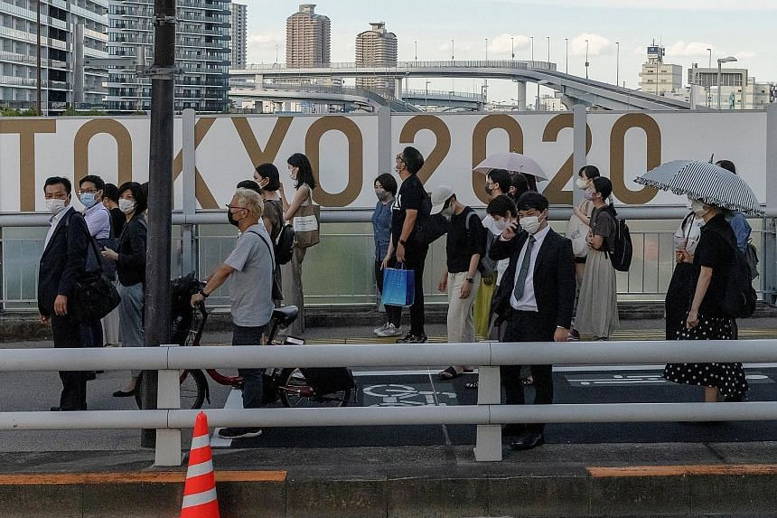 Hiroshima-born Yoshinori Sakai jogged up the 163 steps of the Japan National Stadium to light the Olympic cauldron on Oct 10, 1964, epitomising Japan's commitment to reconstruction and peace. PHOTO: AGENCE FRANCE-PRESSE