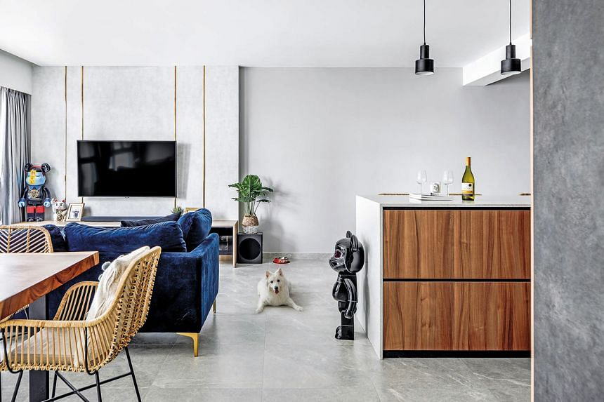The living, dining, and dry kitchen zones are distinct yet connected, allowing guests to interact and move between them freely.