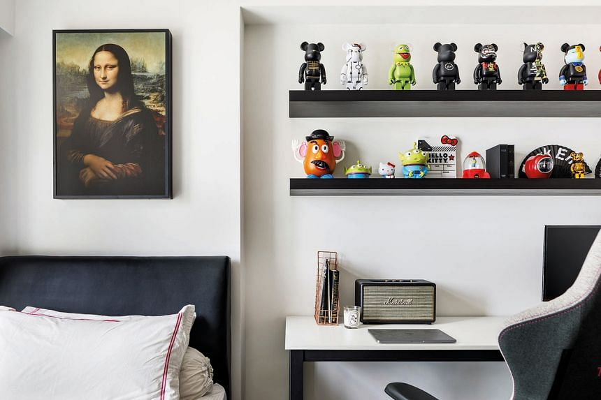 A Mona Lisa painting and toy figurines rest side by side in one of the bedrooms.