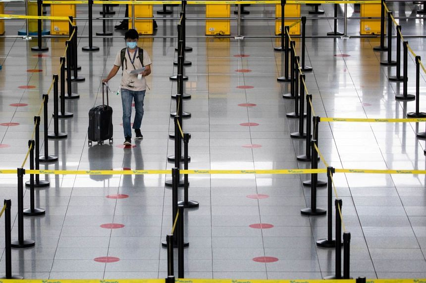 The government announced that its travel ban would now include Malaysia and Thailand. It has already denied entry to travellers from Indonesia and most of South Asia.