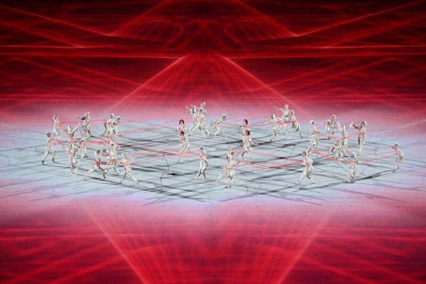 Dancers perform during the opening ceremony of the Tokyo 2020 Olympic Games.