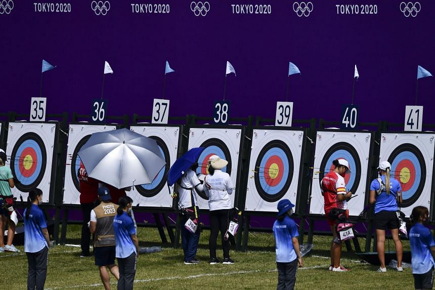Competitors at the women's individual ranking round at Yumenoshima Archery Field in Tokyo, on July 23, 2021.