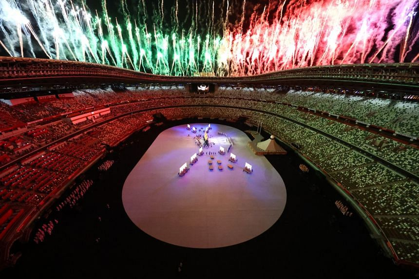 Fireworks explode as performers form the Olympic rings during the opening ceremony.