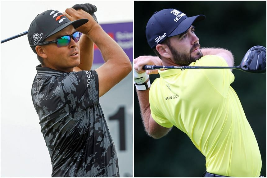Rickie Fowler (left) and Troy Merritt were tied at seven under when play was suspended.