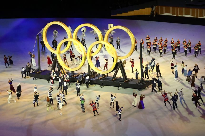 Performers form the Olympic rings during the opening ceremony.