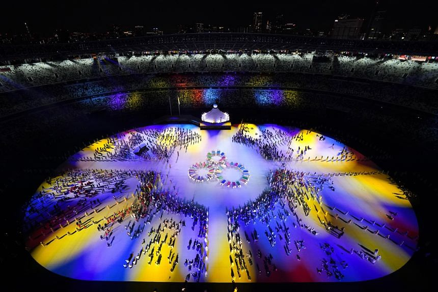 Performers take part in the opening ceremony.