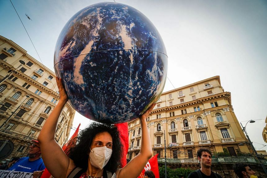 Demonstrators protest against the G-20 climate meeting in Naples, Italy, on July 22, 2021.