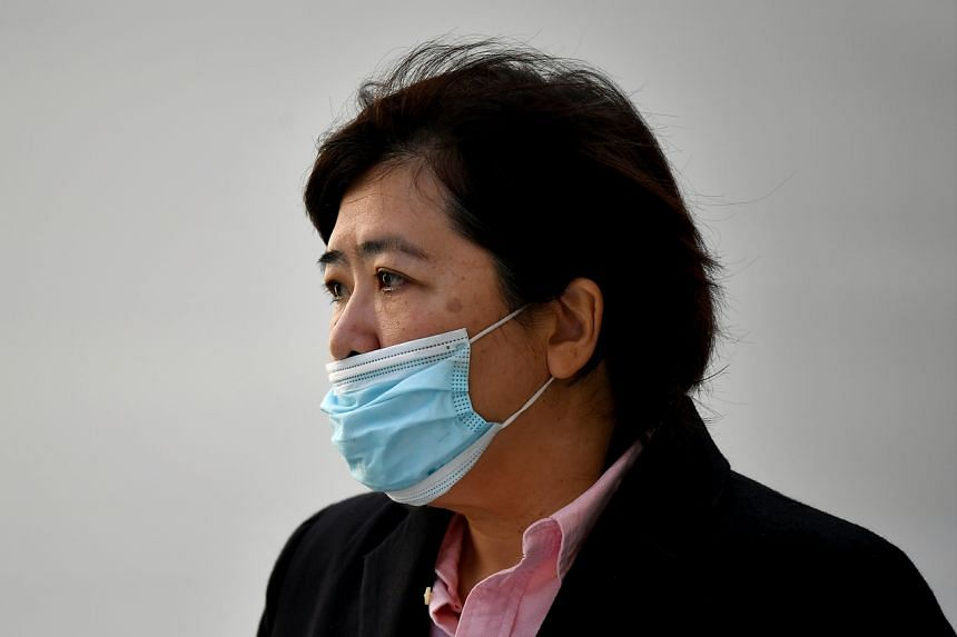 Phoon Chiu Yoke leaving the State Courts on June 15, 2021. She now faces a total of 22 charges.