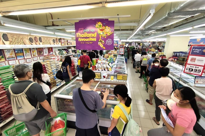 Shoppers at a FairPrice outlet in Jurong East on July 24, 2021.