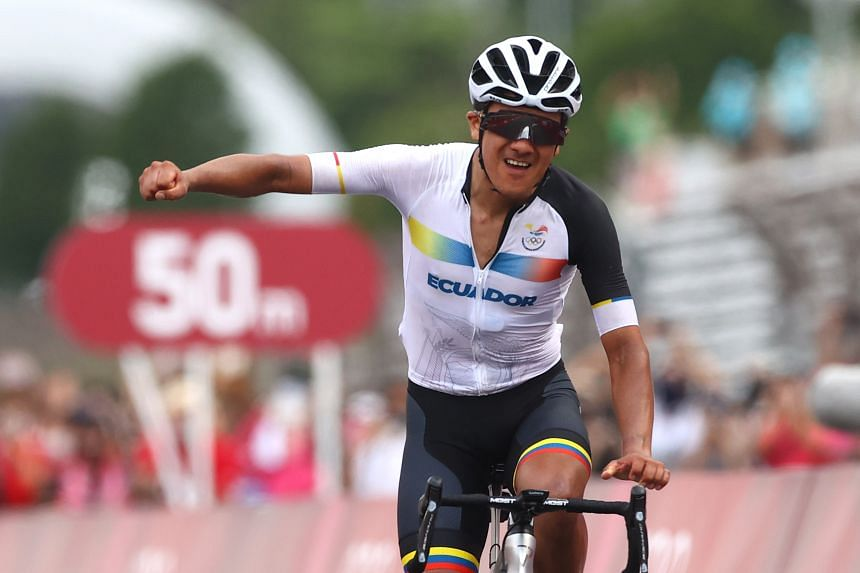 Ecuador cyclist Richard Carapaz celebrates winning gold at the Tokyo Games, on July 24, 2021.