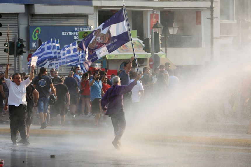 Greek riot police use water cannon to disperse protestors during an anti-vaccine protest held in Athens, Greece, on July 21, 2021.