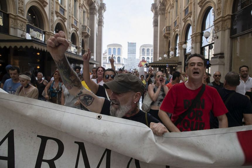 People demonstrate against the Green Pass in Milan, Italy, on July 24, 2021.