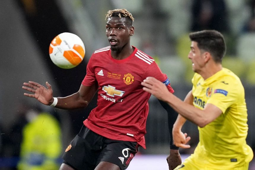 Pogba (left) in action for Manchester United against Villareal in the Europa League.