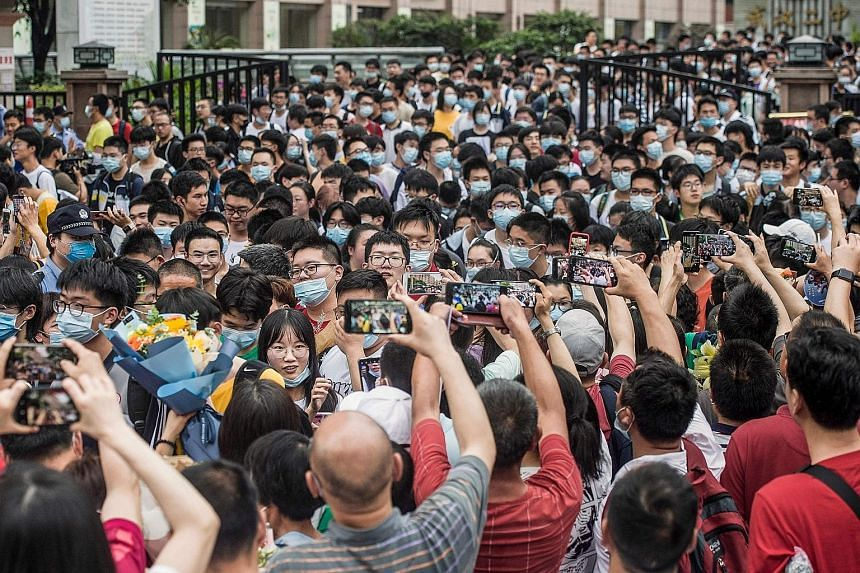 Students leaving a school in Wuhan after finishing the National College Entrance Examination last month. China's for-profit education sector has been under scrutiny as part of Beijing's push to ease pressure on school children and reduce a cost burde