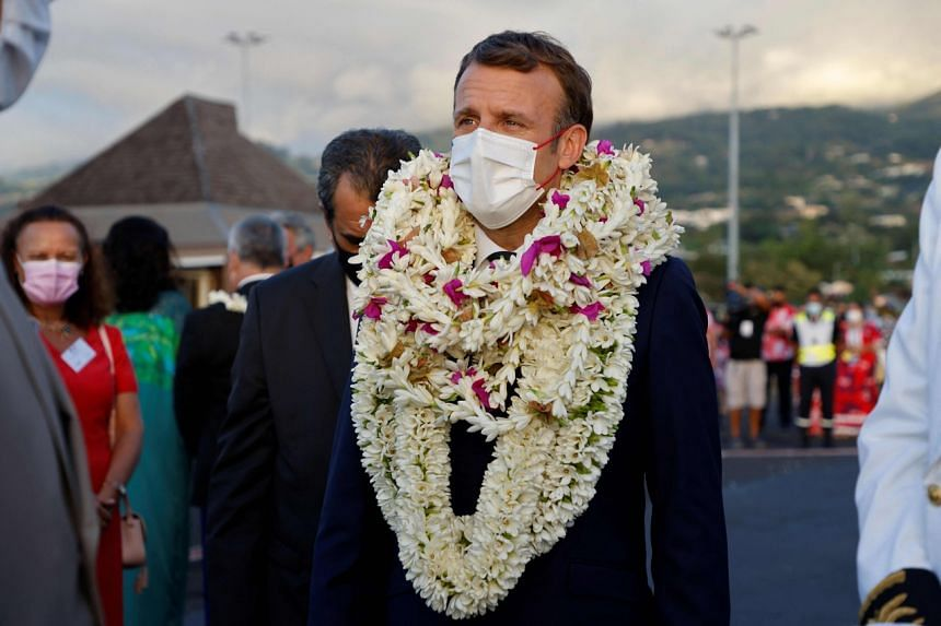 Mr Emmanuel Macron is welcomed upon his arrival at Faa'a international airport for a visit to Tahiti in French Polynesia, on July 24, 2021.