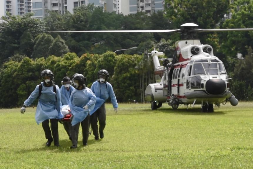 The crew member in one incident being carried on a stretcher following evacuation.