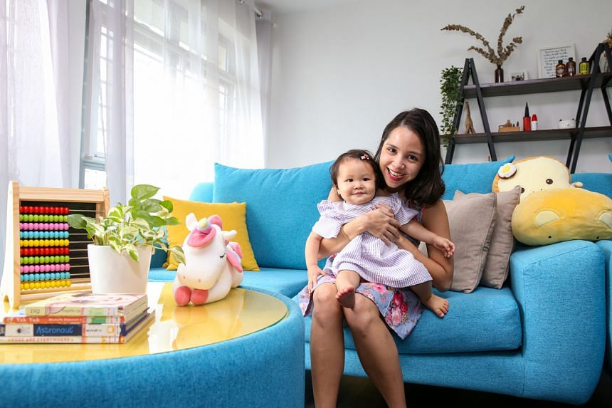 Ms Christel Goh, managing director of GrowPR, and her daughter Fayth Teo, one, in their flat on July 11, 2021.
