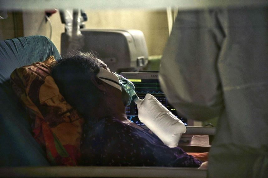 A Covid-19 patient in an intensive care unit at a hospital in Lhokseumawe, Aceh on July 7, 2021.