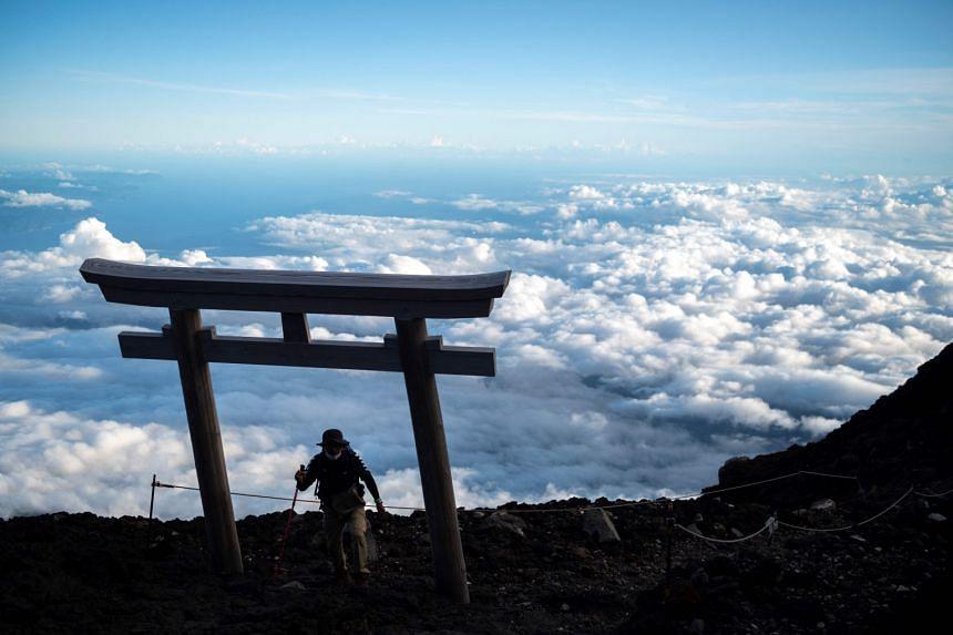 A man reaching the summit of Mount Fuji on July 18, 2021.
