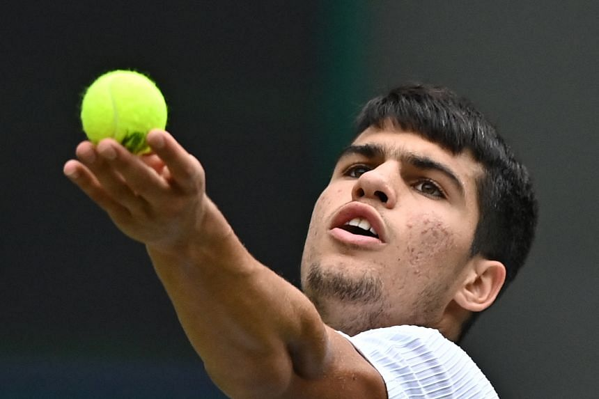 Spain's Carlos Alcaraz in action against Russia's Daniil Medvedev during the Wimbledon Championships on July 1, 2021.