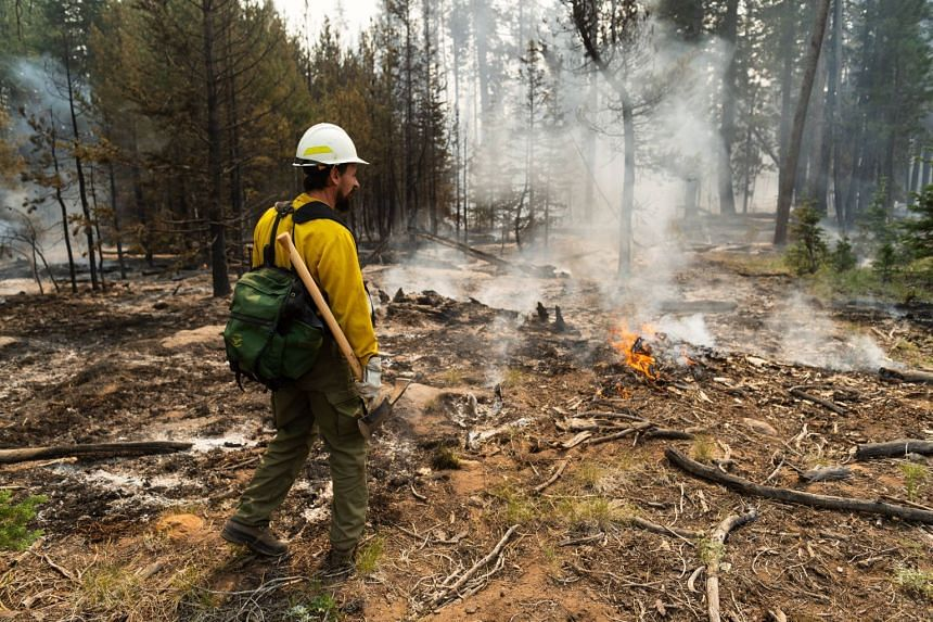 Fire Information officer Jacob Welsh leads a media tour on the northern front of the Bootleg Fire on July 23, 2021 near Silver Creek, Oregon.