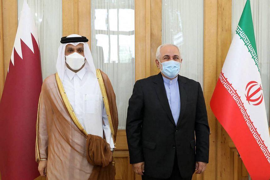 Iran's Foreign Minister Mohammad Javad Zarif (right) receiving his Qatari counterpart Sheikh Mohammed bin Abdulrahman Al-Thani on July 25, 2021.