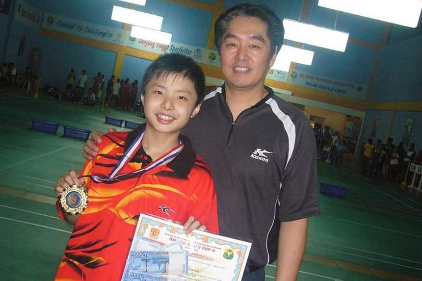 Shi Yuqi (left) was 10 when he was scouted by former Singapore national coach and Singapore Badminton School founder Zhang Qing Song.