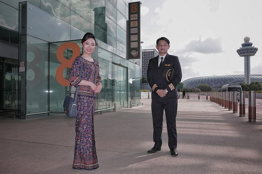 Scoot flight steward Jimmy Pung, 37, returned to flying in December after working for nine months as a community service executive. Jetstar Asia flight stewardess Raudhah Rihat (right), 41, hopes leisure travel will return soon. With her is flight st